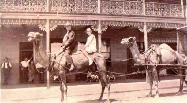 Halbert, Ruby on a camel outside the Royal Mail Hotel Meekatharra WA Abt. 1931-3