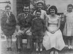 Perrin, Charles Stewart wife Olga Jean Reid, Stewart Warner standing between parents, Charles Thomas , Elizabeth Ann at the back & Margaret Lorraine Fr Marie.