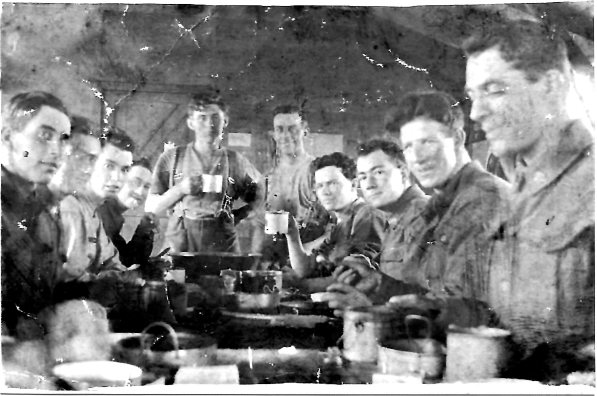 Bryant, William at rear (with mug) France or Belgium 1918-19 working cookhouse.